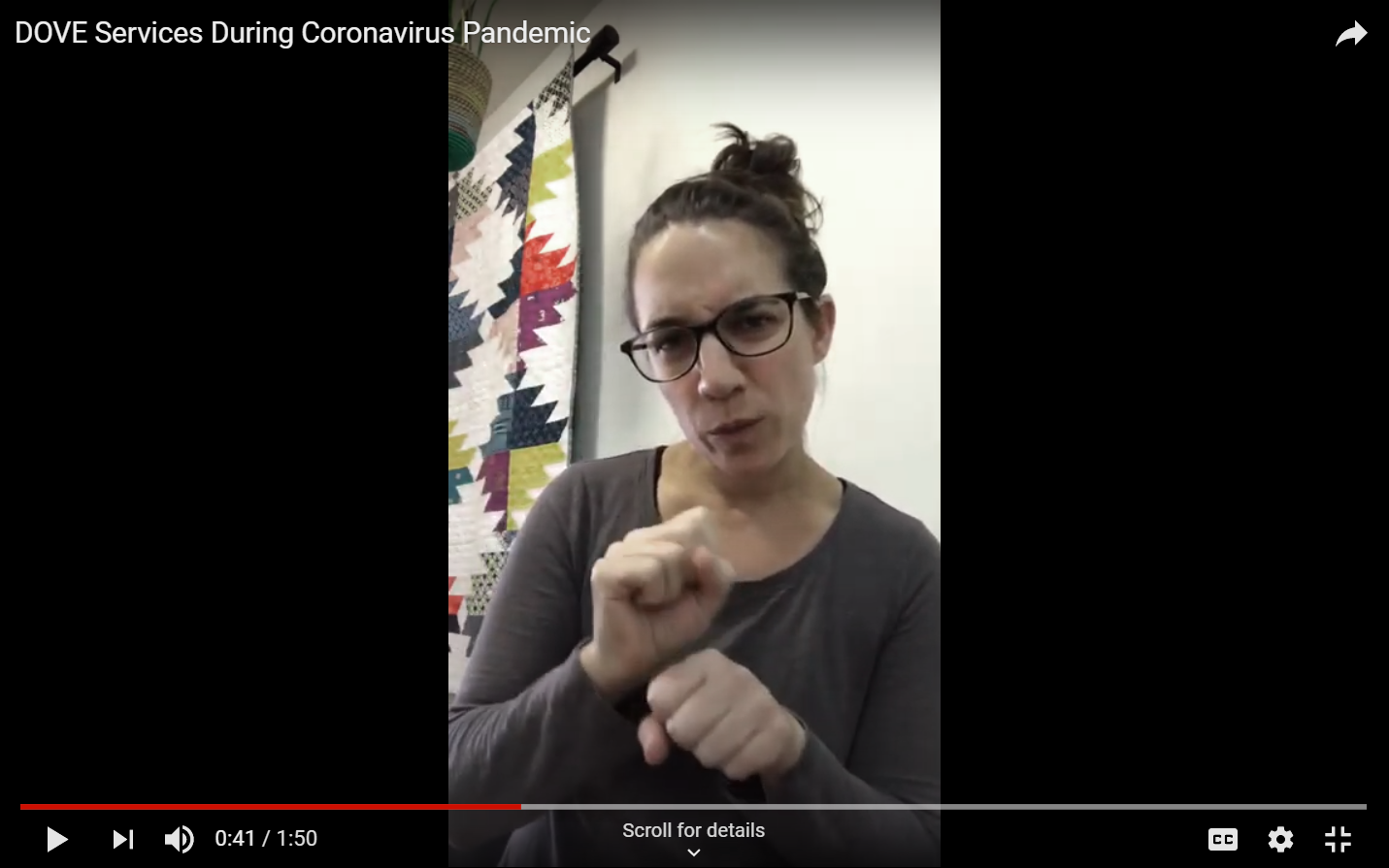 Screenshot of a YouTube video with Avi captured mid-sign.